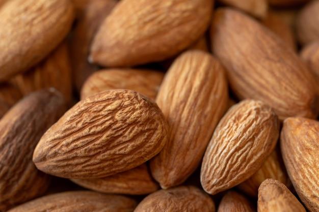 Amandelen noten close-up natuurlijke achtergrond voor gezond eten concept ondiepe scherptediepte