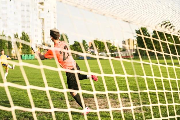 Amateurvoetbalconcept met keeper
