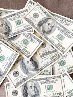 Amerikaanse geld achtergrondtextuurrekeningen van 100 amerikaanse dollars