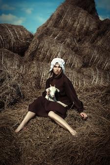 Amish stijl model poseert met dieren