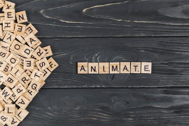 Animeer woord op houten achtergrond