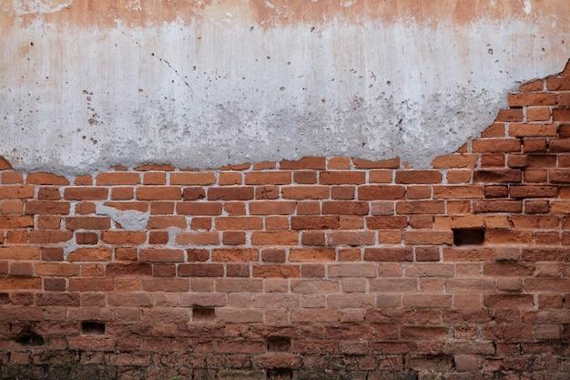 Antieke bruine bakstenen muur van rode kleur. textuur grunge achtergrond.