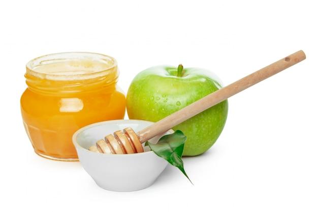 Appelen en honingskruik voor joodse geïsoleerde nieuwe jaarvakantie