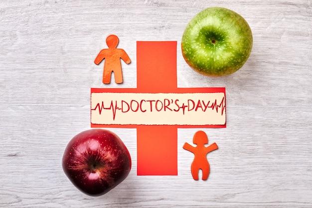 Appels, stickmen en kruis. creatief idee voor doctor's day.