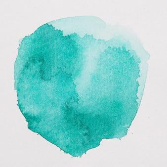 Aquamarijn verven in de vorm van een cirkel op wit papier