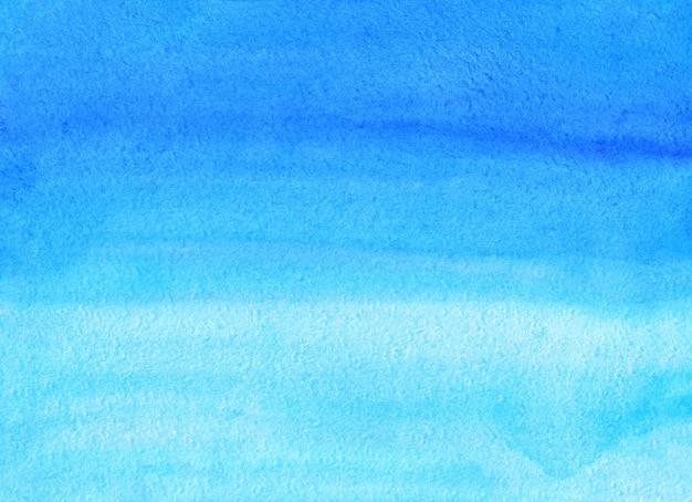 Aquarel blauwe ombre achtergrond hand geschilderd. aquarelle hemelsblauw textuur.