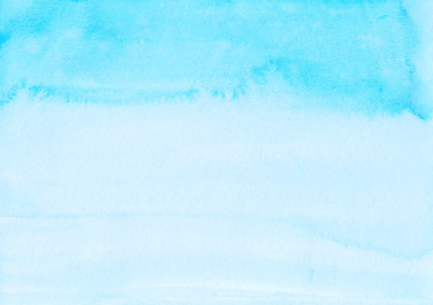 Aquarel lichtblauwe ombre achtergrond hand geschilderd. aquarelle hemelsblauw textuur.