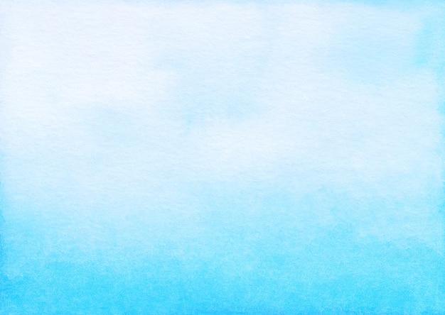Aquarel lichtblauwe ombre achtergrond hand geschilderd