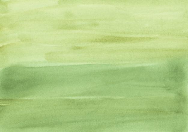 Aquarel mosterd groene kleur achtergrondstructuur. aquarelle abstracte achtergrond. vlekken op papier. Premium Foto