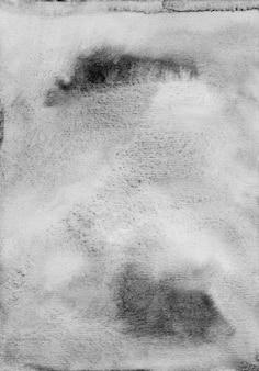 Aquarel oude grunge lichtgrijze achtergrondstructuur. zwart-witte vlekken op papier overlay.