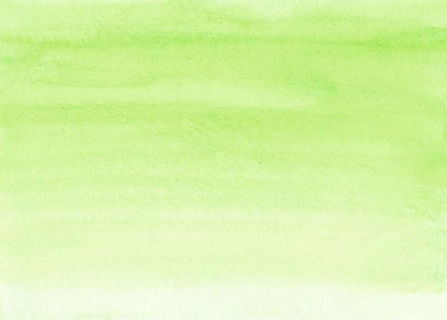 Aquarel pastel limoen groene kleur achtergrondstructuur. aquarelle geelgroene overlay met de hand geschilderd. vlekken op papier.