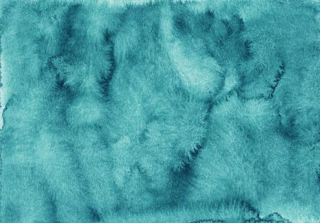 Aquarel turkooizen achtergrond textuur hand geschilderd. vlekken op papier.