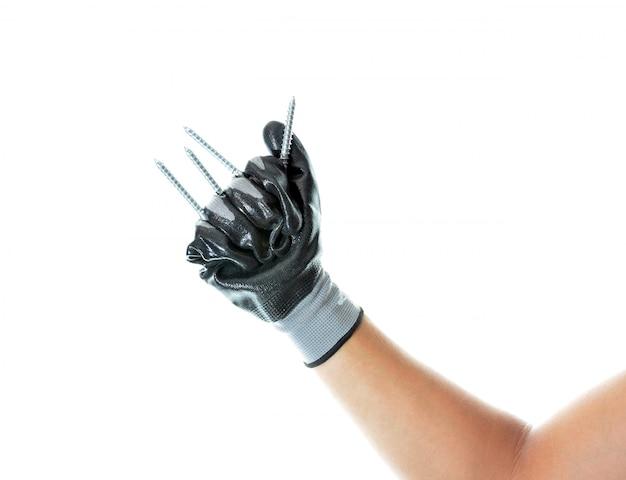 Arbeider die een hulpmiddel houdt om met uw hand te werken