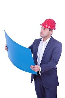 Architect in de rode blauwdruk van de bouwvakkerholding