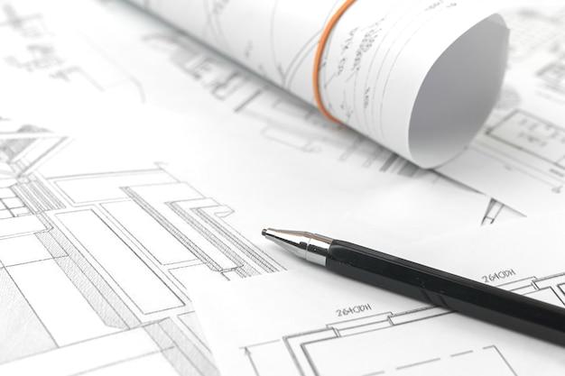 Architect ontwerp werkachtergrond, schets plannen blauwdrukken tekenen en architecturale constructies concept foto maken