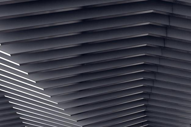 Architecturale achtergrond moderne metalen gebogen compositie in perspectief halfronde vormen het licht op het einde