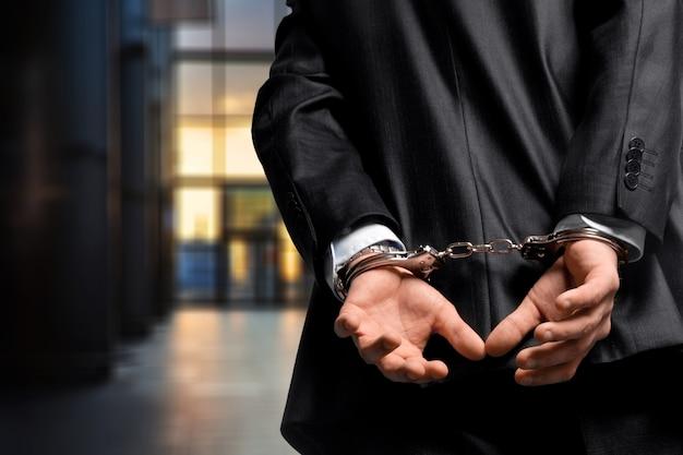Arrestatie gebonden armband omkoping omkoping zakelijke zakenman