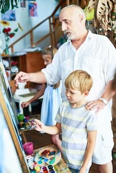 Art teacher helping children