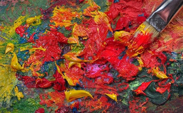 Artist's palet en penseel textuur achtergrond. detailopname