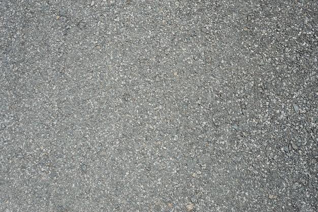 Asfaltweg met het merken van de textuurachtergrond van lijnen witte strepen.
