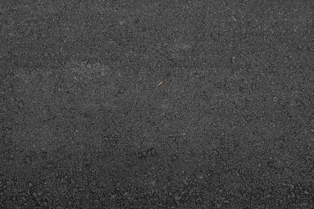 Asfaltweg textuur en achtergrond. plat liggen. bovenaanzicht
