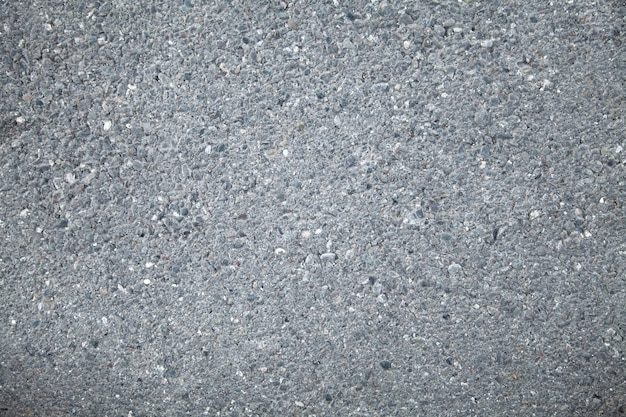 Asfaltwegachtergrond of textuur