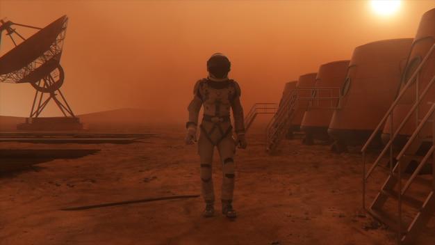 Astronaut op de planeet mars, die een omweg maakt rond zijn basis. astronaut loopt langs de basis.