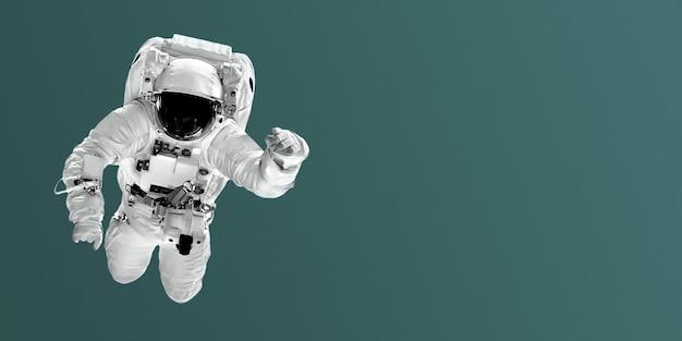 Astronaut vliegt over trendkleurachtergronden. elementen van deze afbeelding geleverd door nasa