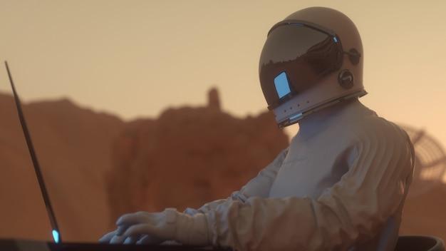 Astronaut werkt op zijn wetenschappelijke laptop in een ruimtekolonie op een van de planeten. 3d-rendering.