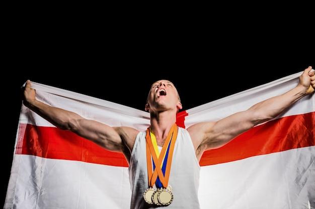 Atleet het stellen met gouden medailles na overwinning