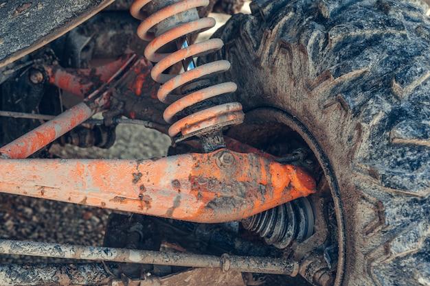 Atv quad, close-up van details: koplampen, schokbreker