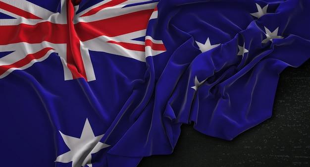 Australische vlag gerimpelde op donkere achtergrond 3d render