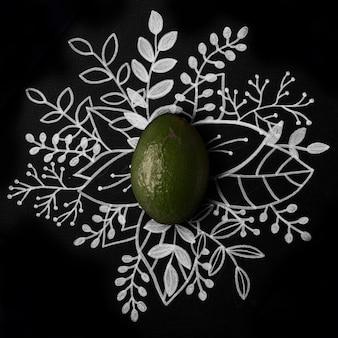 Avocado over schets bloemen hand getrokken
