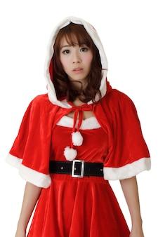 Aziatisch kerstmismeisje met bezorgde uitdrukking op gezicht tegen wit.