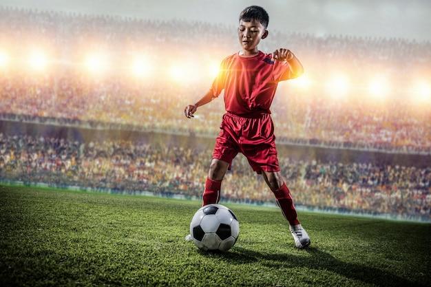 Aziatische voetbal kinderen actie in het stadion tijdens de wedstrijd