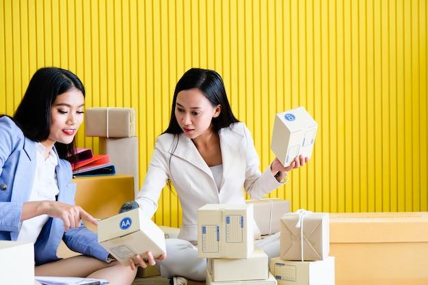 Aziatische vrouw die een klein bedrijf begint