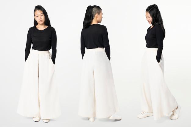 Aziatische vrouw in witte palazzobroek met ontwerpruimte vrijetijdskleding mode full body