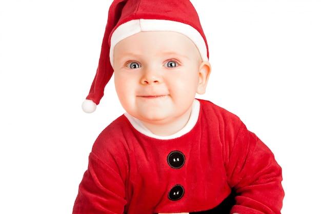 Baby in kerstmankostuum met kerstmis