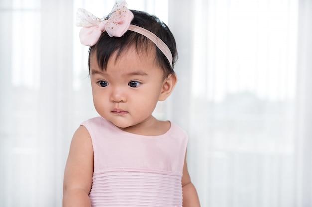 Baby in roze jurk