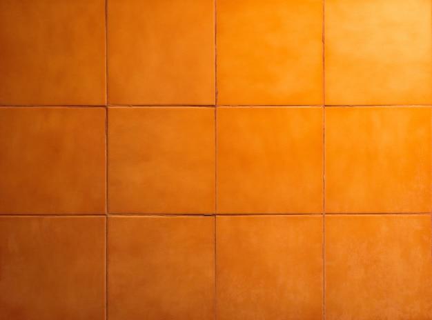 Badkamerstegels met oranje achtergrond. oppervlak van muur en vloer.