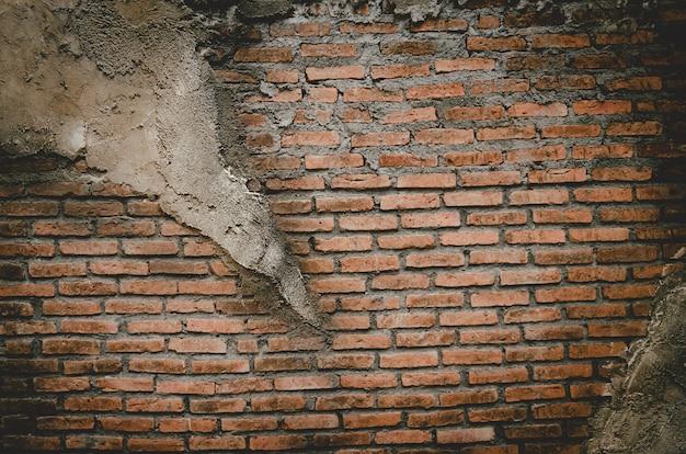 Baksteen, blok, sinaasappel en mortel muur als textuurachtergrond.