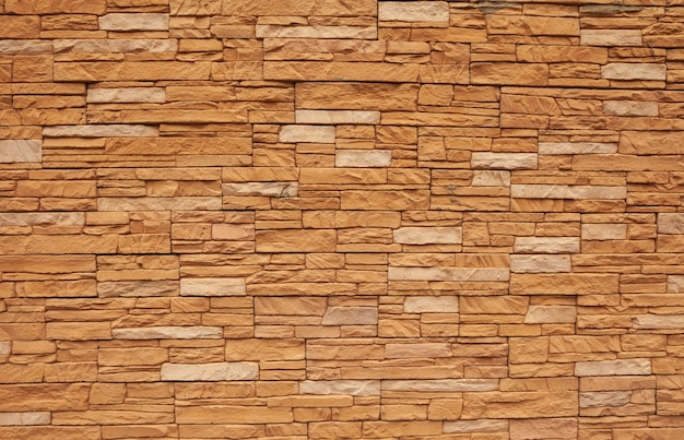 Baksteenachtergrond, muur of textuur van oranje blokken