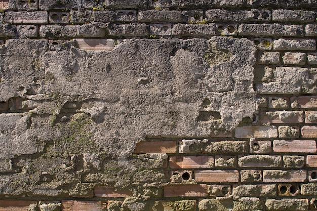 Bakstenen muur in cement