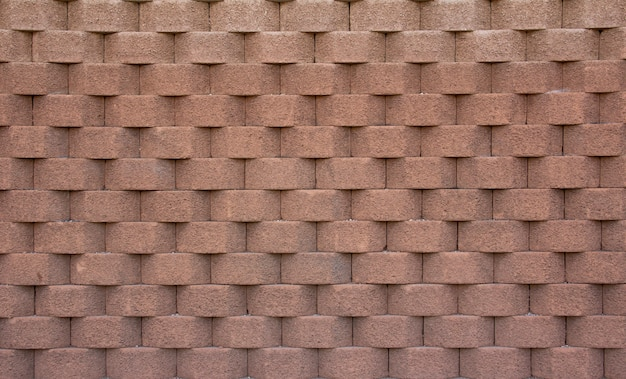 Bakstenen muur met lichtbruine geometrische vormen. gevoel van diepte. textuur. achtergrond.