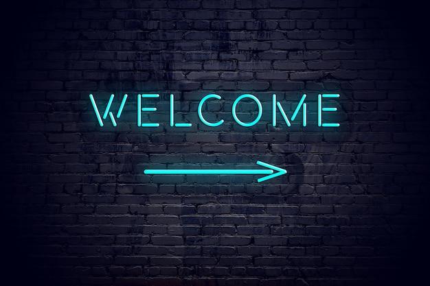 Bakstenen muur met neon pijl en teken welkom.