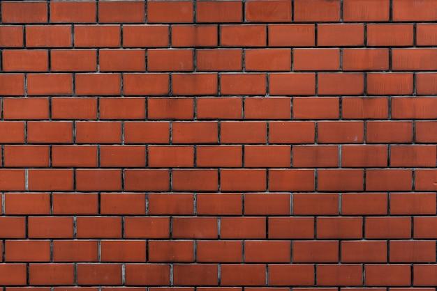 Bakstenen muur oranje behangpatroon