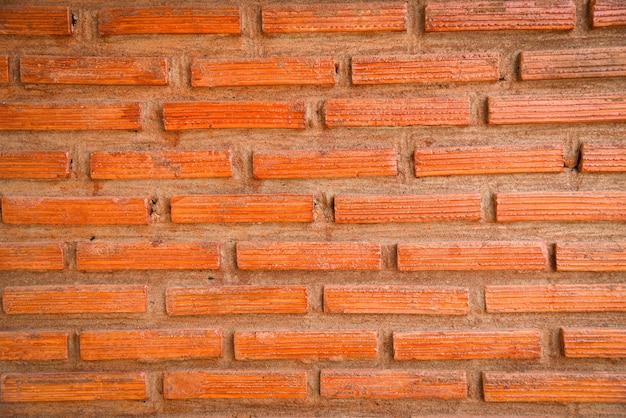 Bakstenen muurachtergrond / rode baksteen met cement concreet pleister op de achtergrond van de muurtextuur
