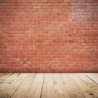 Bakstenen muurruimte en houten vloerachtergrond en textuur met exemplaarruimte.