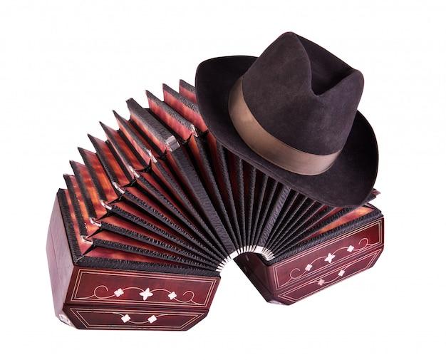 Bandoneon, tango-instrument met een mannelijke hoed op de top