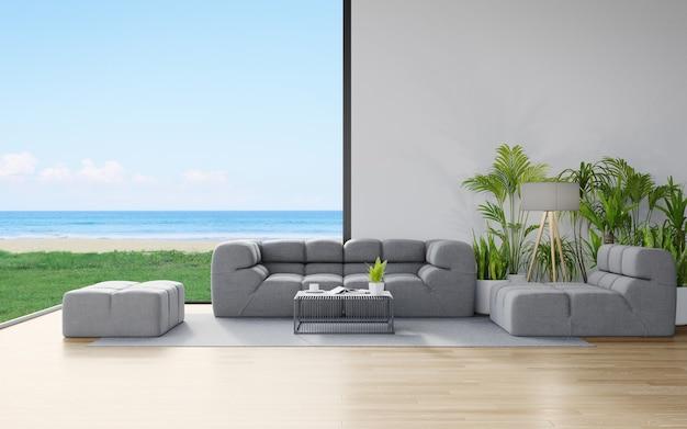 Bank op houten vloer van grote woonkamer in modern huis of luxehotel met uitzicht op de lucht en de zee